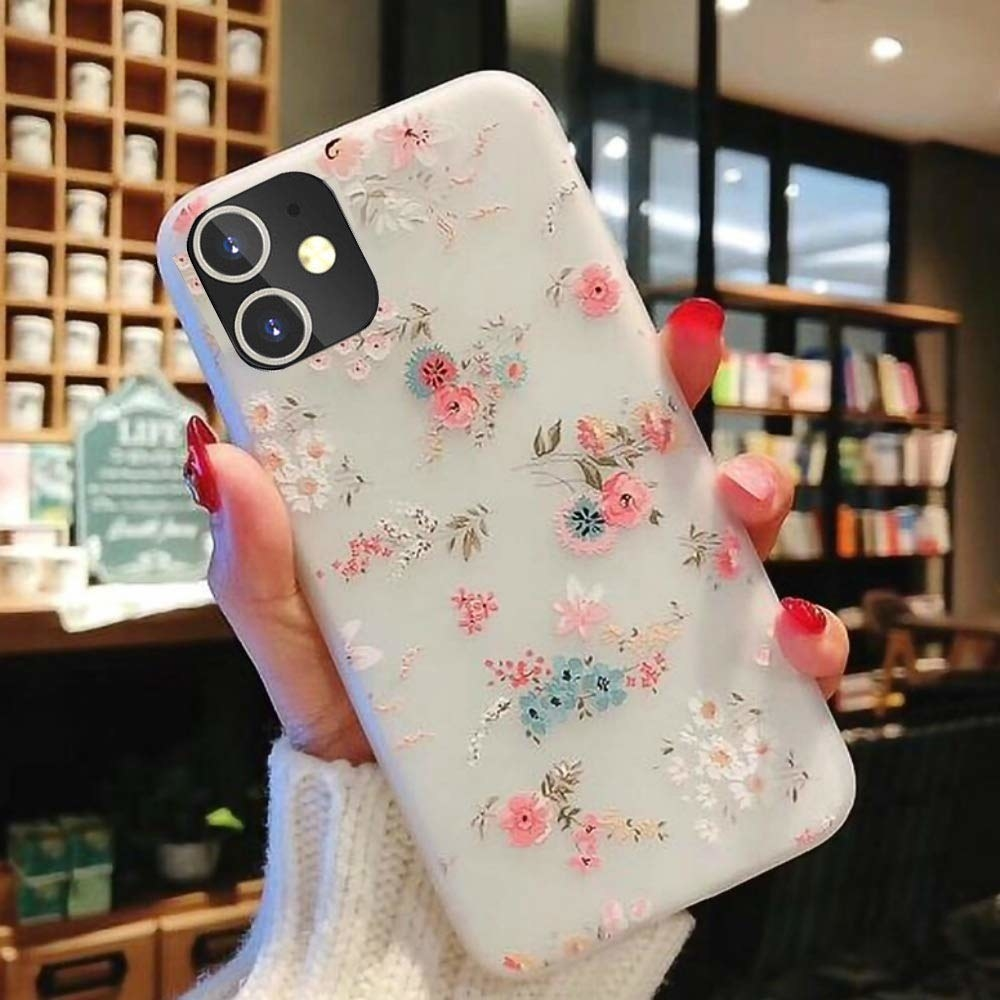 The floral phone case on a phone with a person holding it