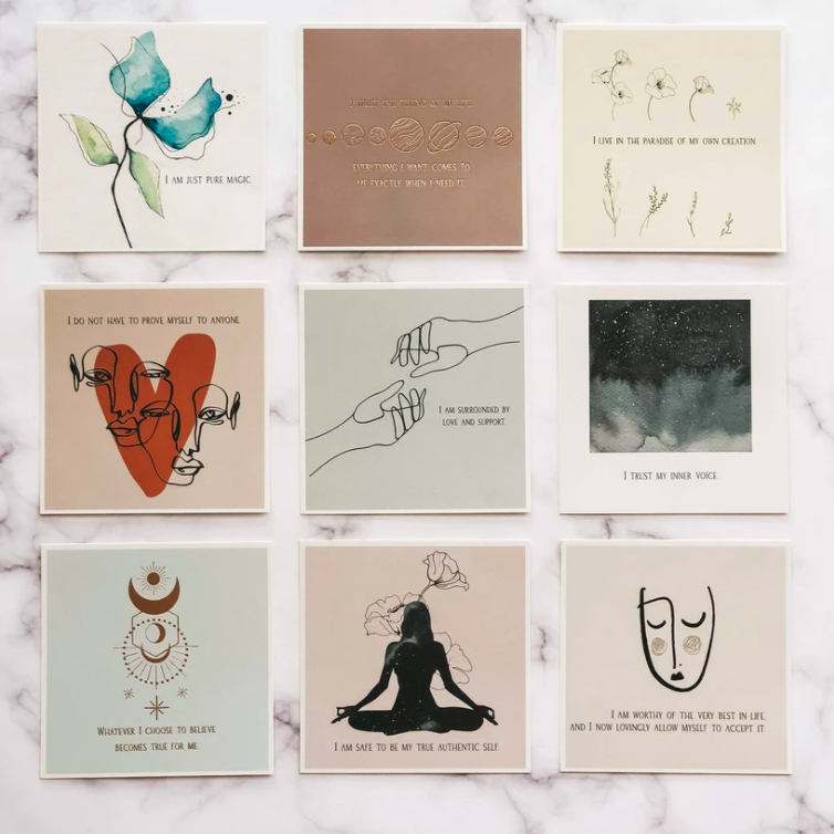 Nine affirmation cards laid out on a marble table