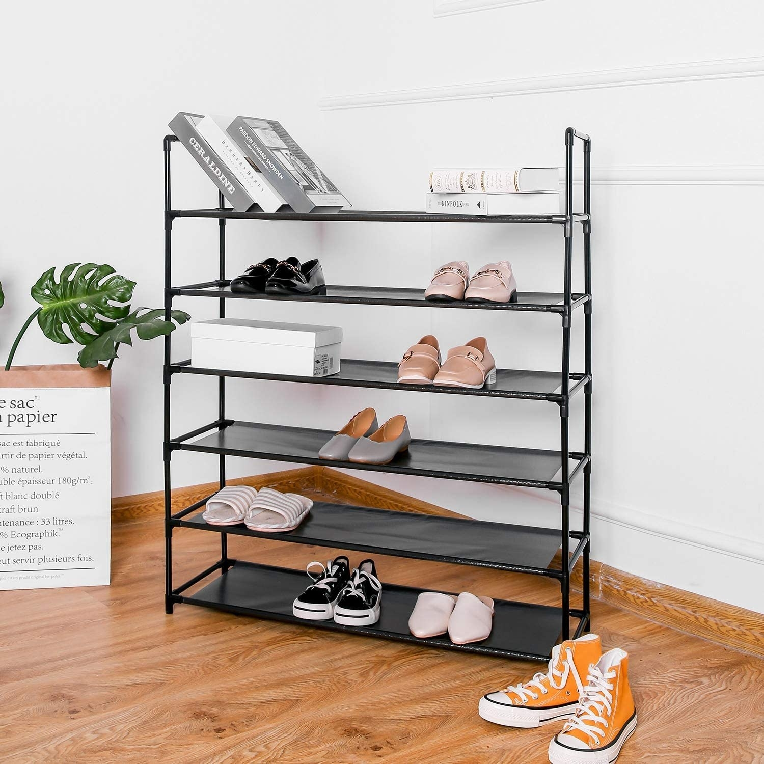 A large shoe rack with different types of footwear on each row