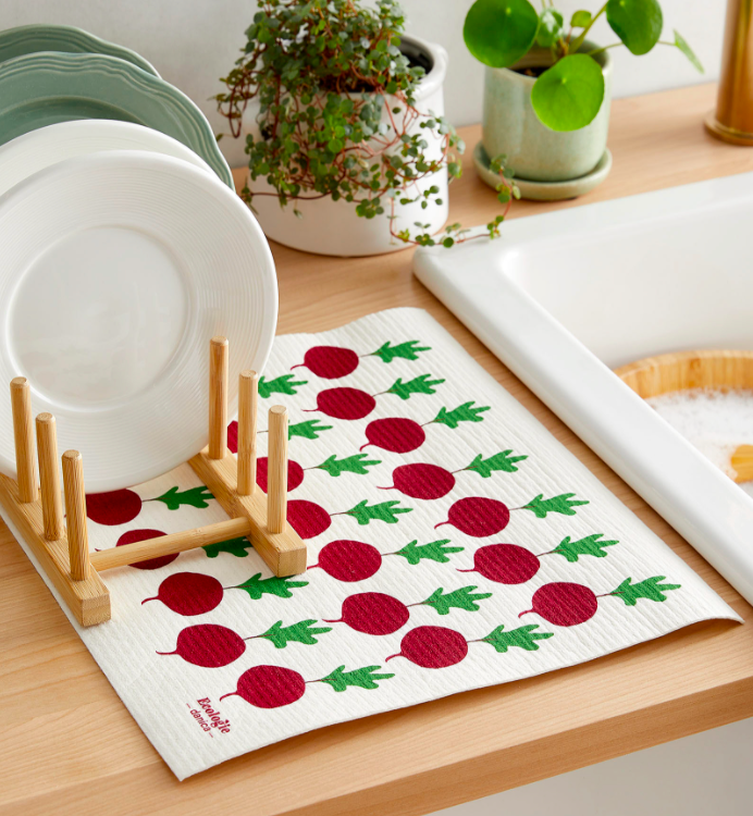 The mat with a full dish rack on top of it