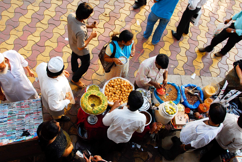People eating snacks on the street in Mumbai.