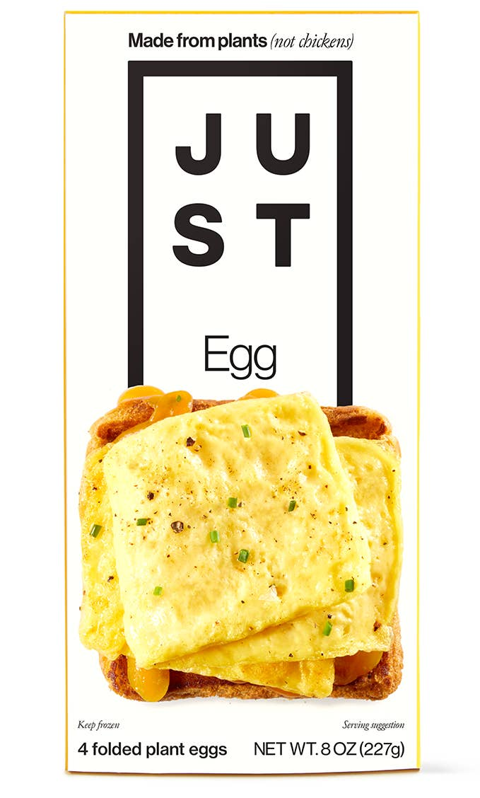 A box with a folded egg on a piece of toast