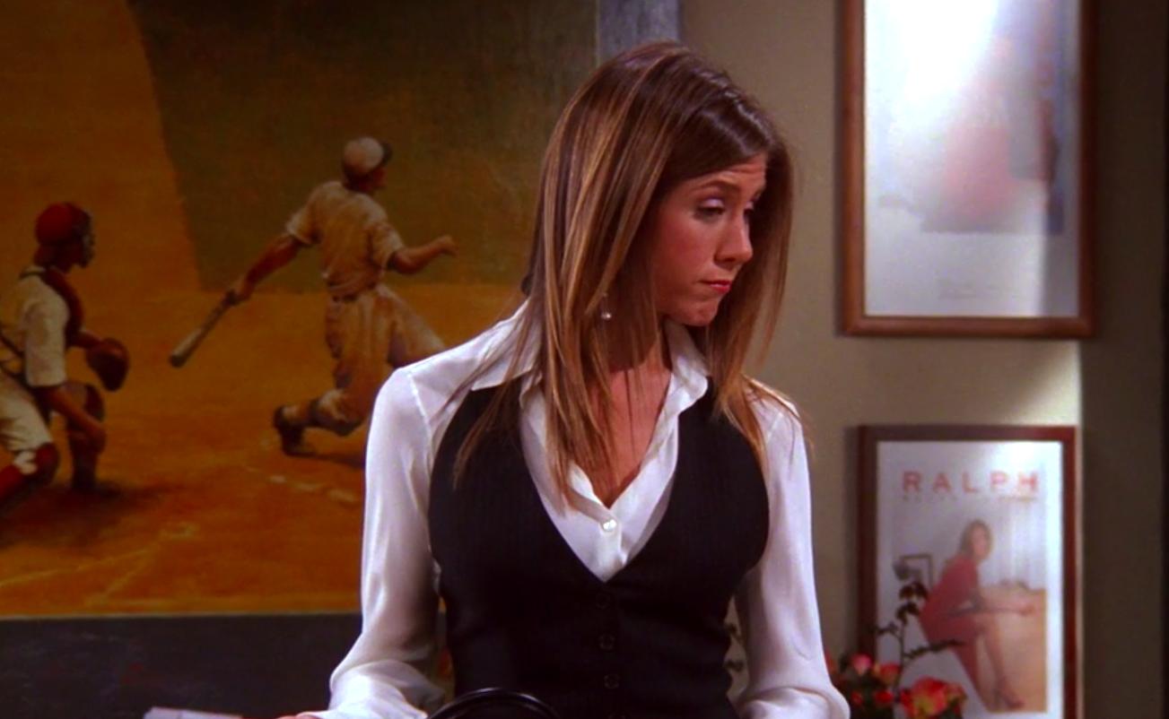 Rachel wearing a suit to work