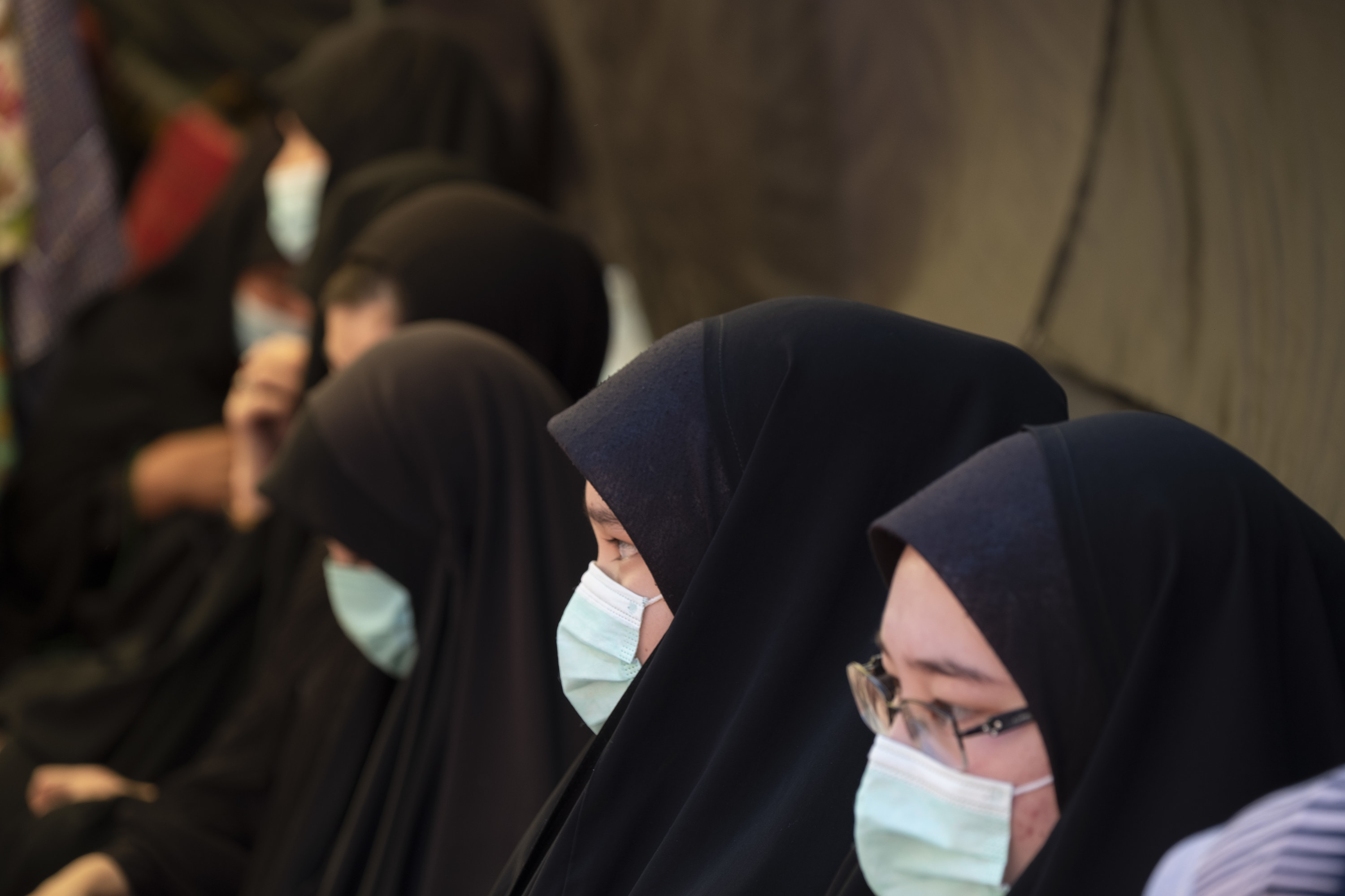 Women wearing hijab and surgical masks
