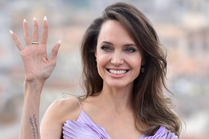 Angelina Jolie waving and smiling
