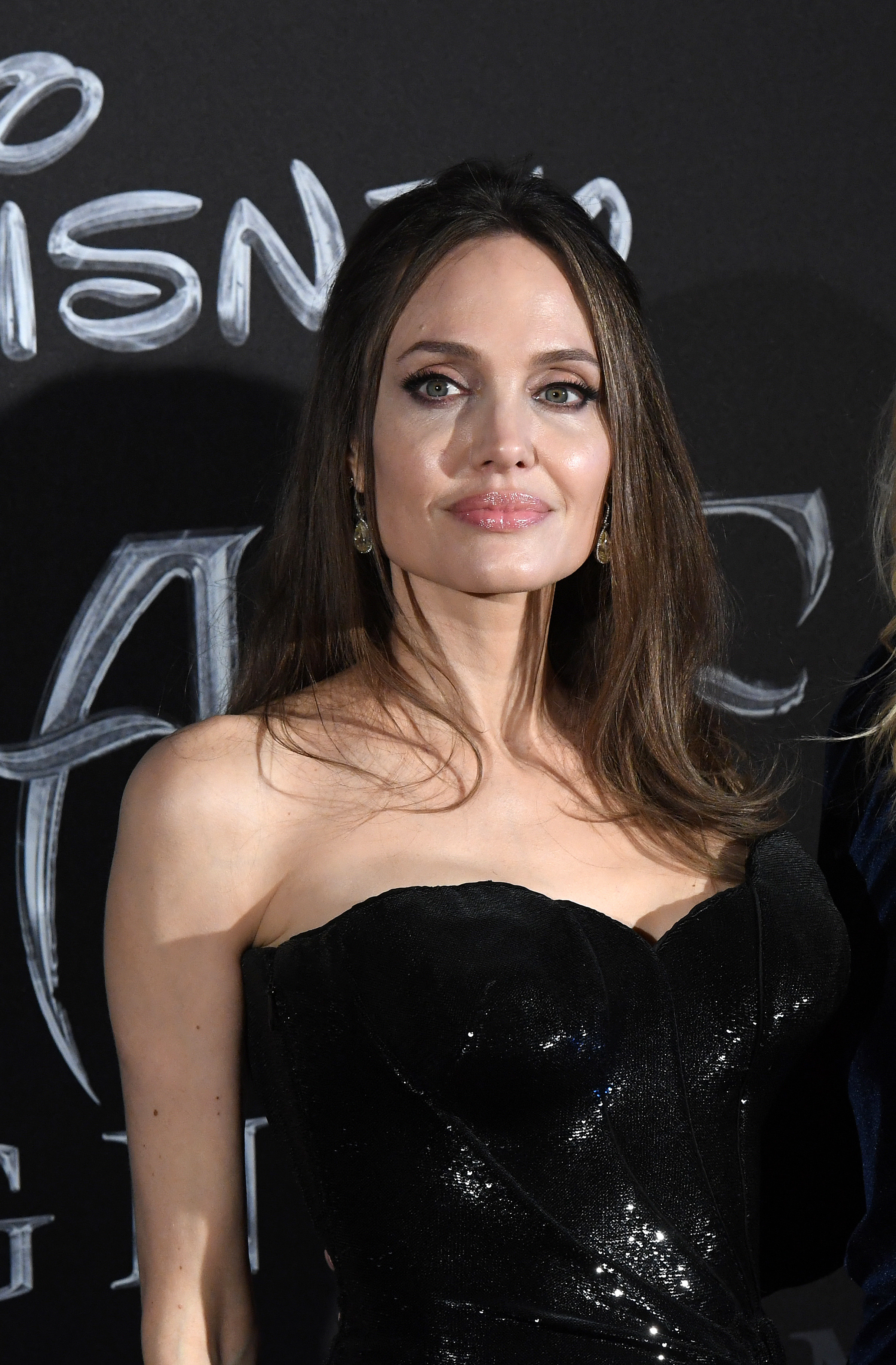 Angelina Jolie in a strapless outfit on the red carpet