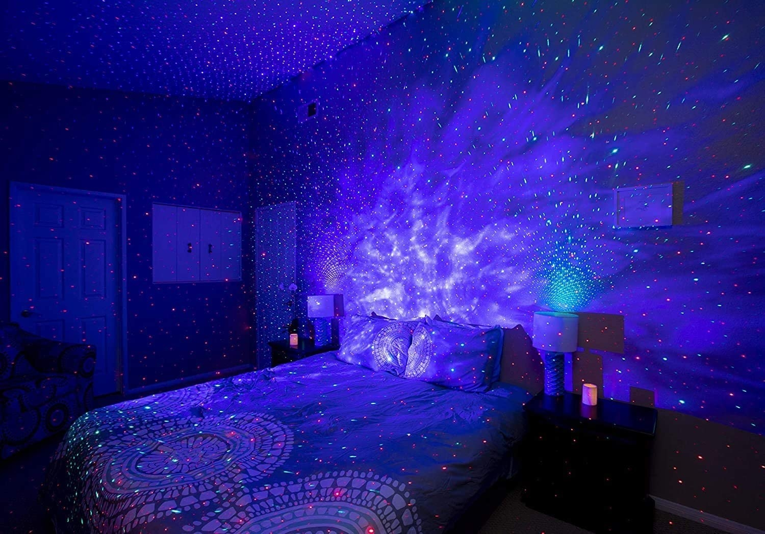 the blue and grey version of the galaxy light over a bed