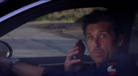 Derek answering cell phone and about to get hit