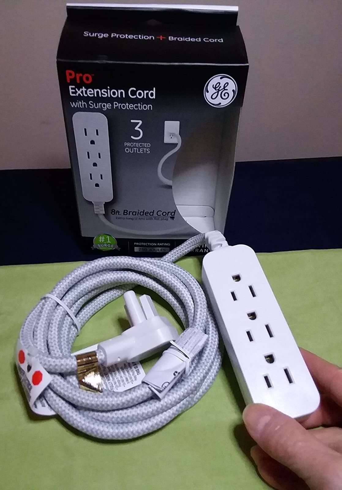 reviewer holding the GE extension cord