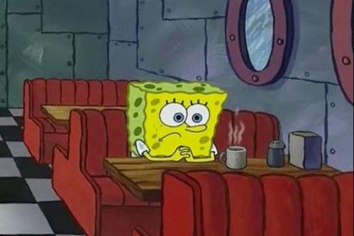 "SpongeBob looking sad sitting at a diner on ""SpongeBob SquarePants"""