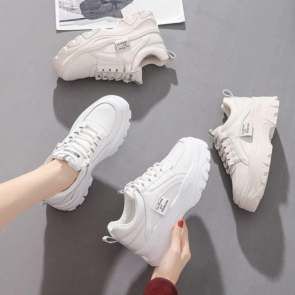 A model wearing the chunky white sneakers