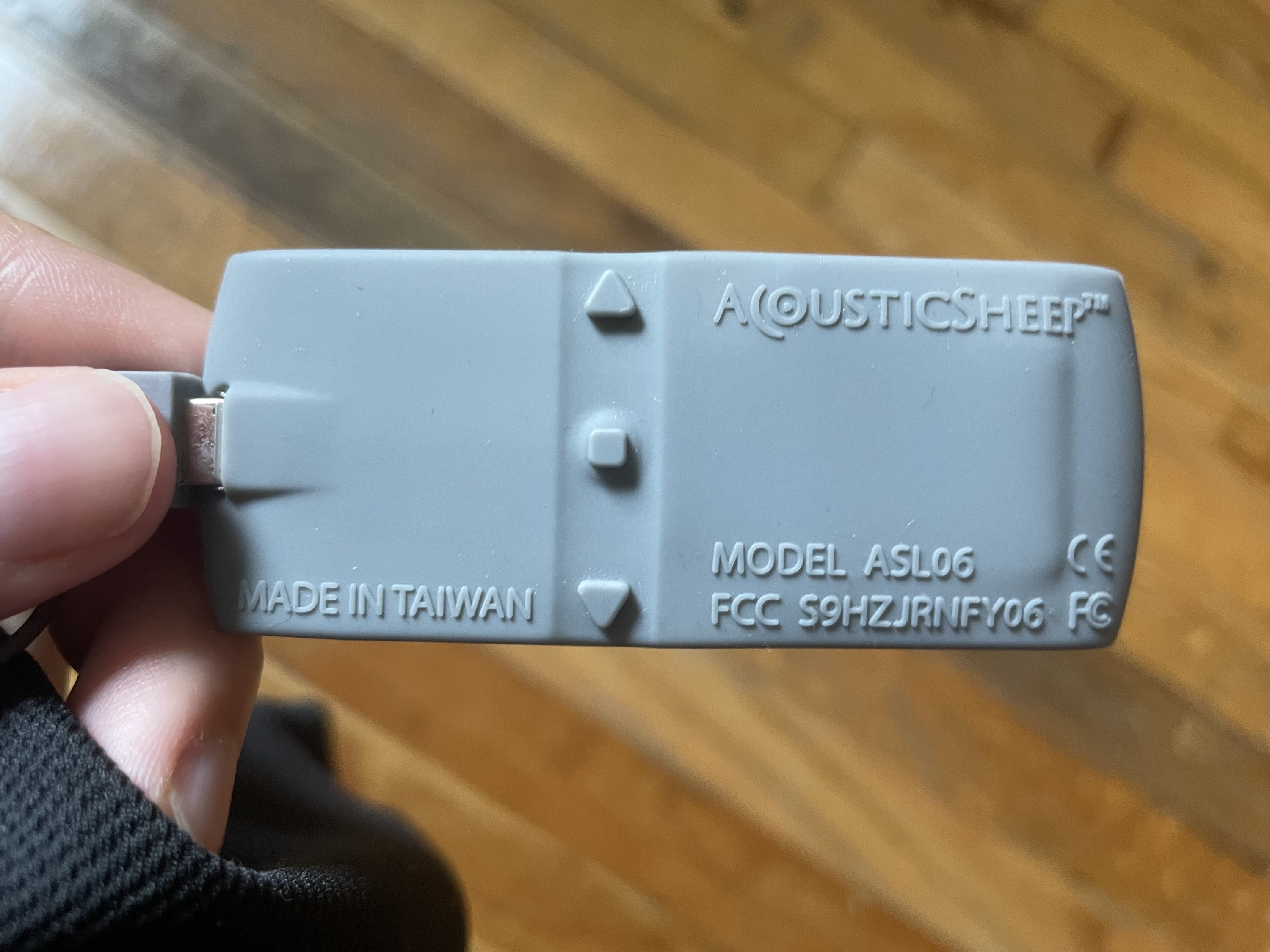 the grey silicone battery pack with an an on/off button and volume up and volume down button, all in a vertical line