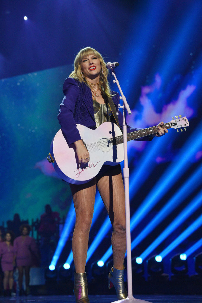 Photo of Taylor Swift in gold top, performing at the 2019 VMAs