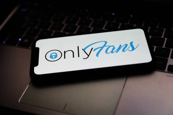 OnlyFans logo is seen displayed on a phone screen