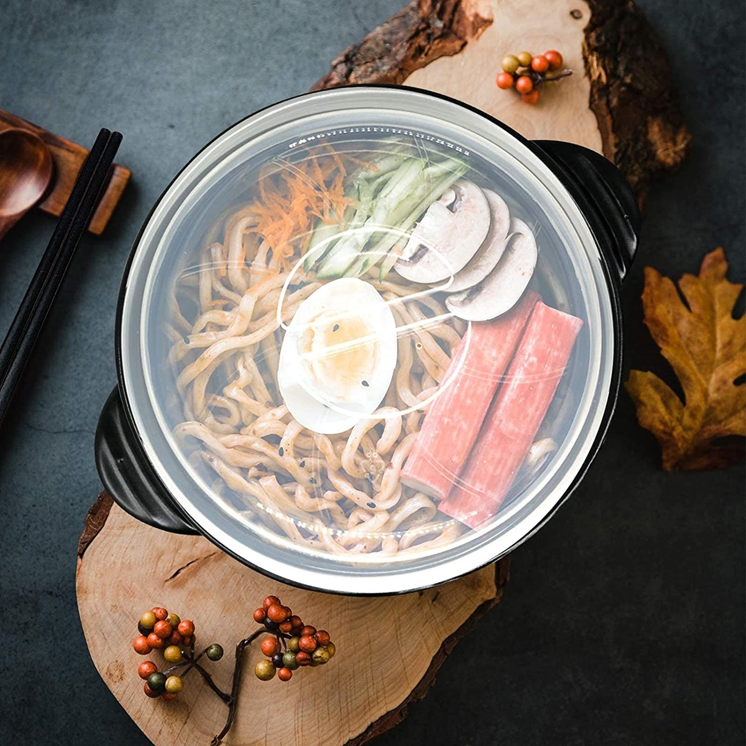 The bowl filled with udon on a wooden serving board