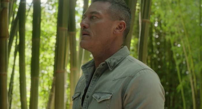 Lars stands in a bamboo forrest looking sneaky