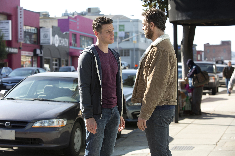 Jonathan Groff talks to Murray Bartlett on a street
