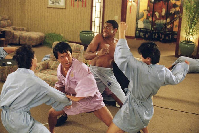 Jackie Chan and Chris Tucker fighting two people in bathrobes