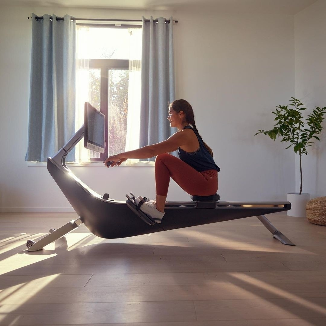 a model on the rowing machine
