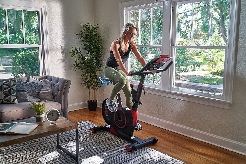 a model on an echelon spin bike