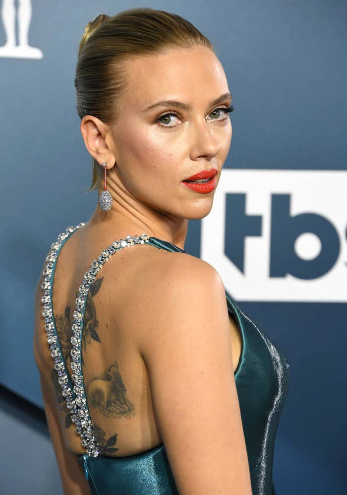 Scarlett on the red carpet showing off her back tattoos
