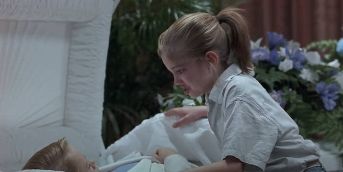 Vada cries as she looks at Thomas J in his coffin
