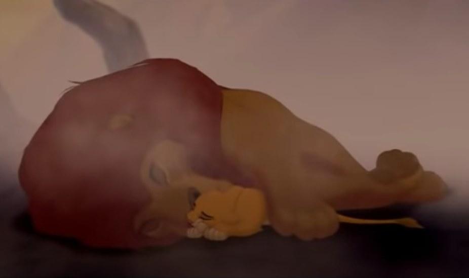 Simba lies next to a dead Mufasa