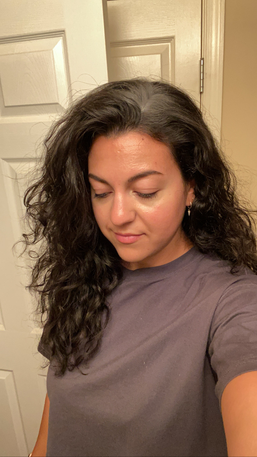 The author applying dry shampoo