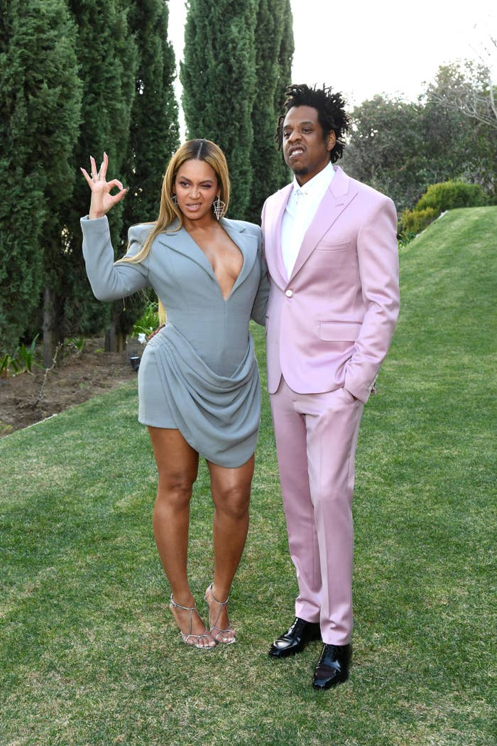 Beyoncé doing the 'OK' gesture as she poses for a photo with Jay-Z