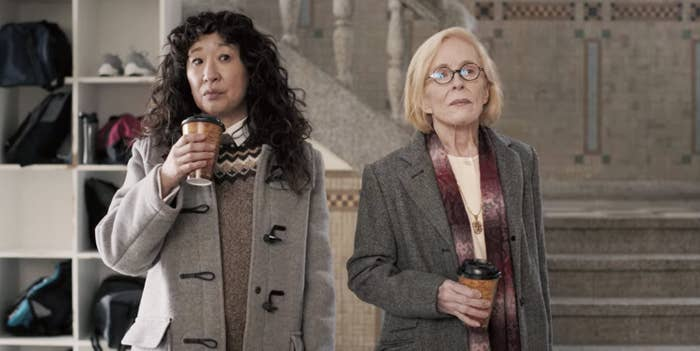 Sandra Oh and Holland Taylor standing next to one another with coffee cups in their hands in The Chair