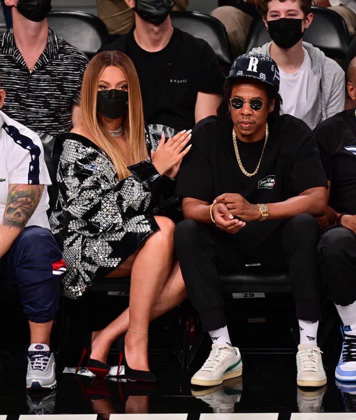 Beyoncé and Jay-Z sitting front row at a basketball game
