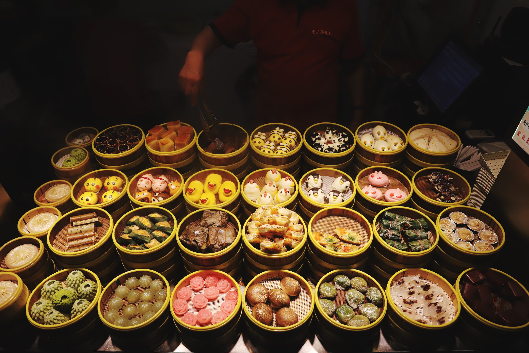 Lots of colorful dim sum at a street market.