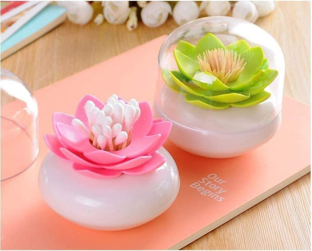the holders in pink and green with white round bases holding swabs and toothpicks with clear covers