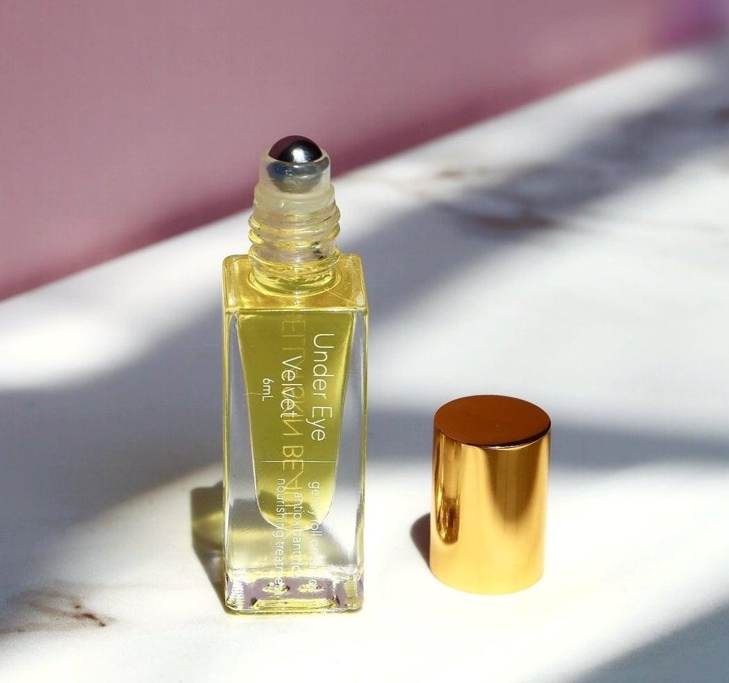 the bottle of roll-on under eye oil