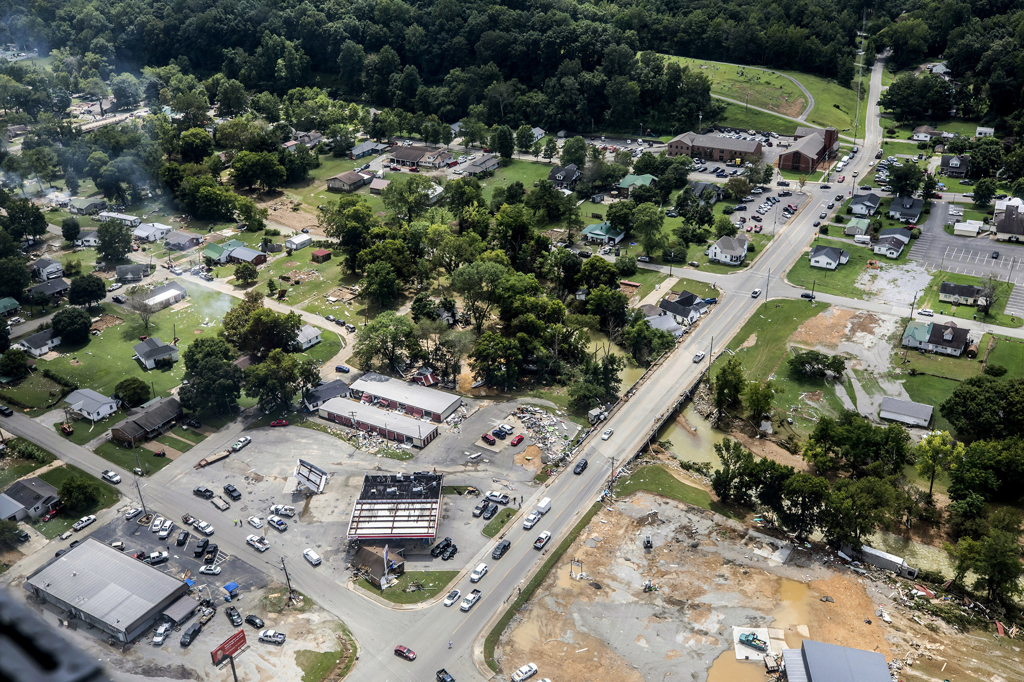 An aerial view of Waverly shows blocks of destroyed buildings and flooding