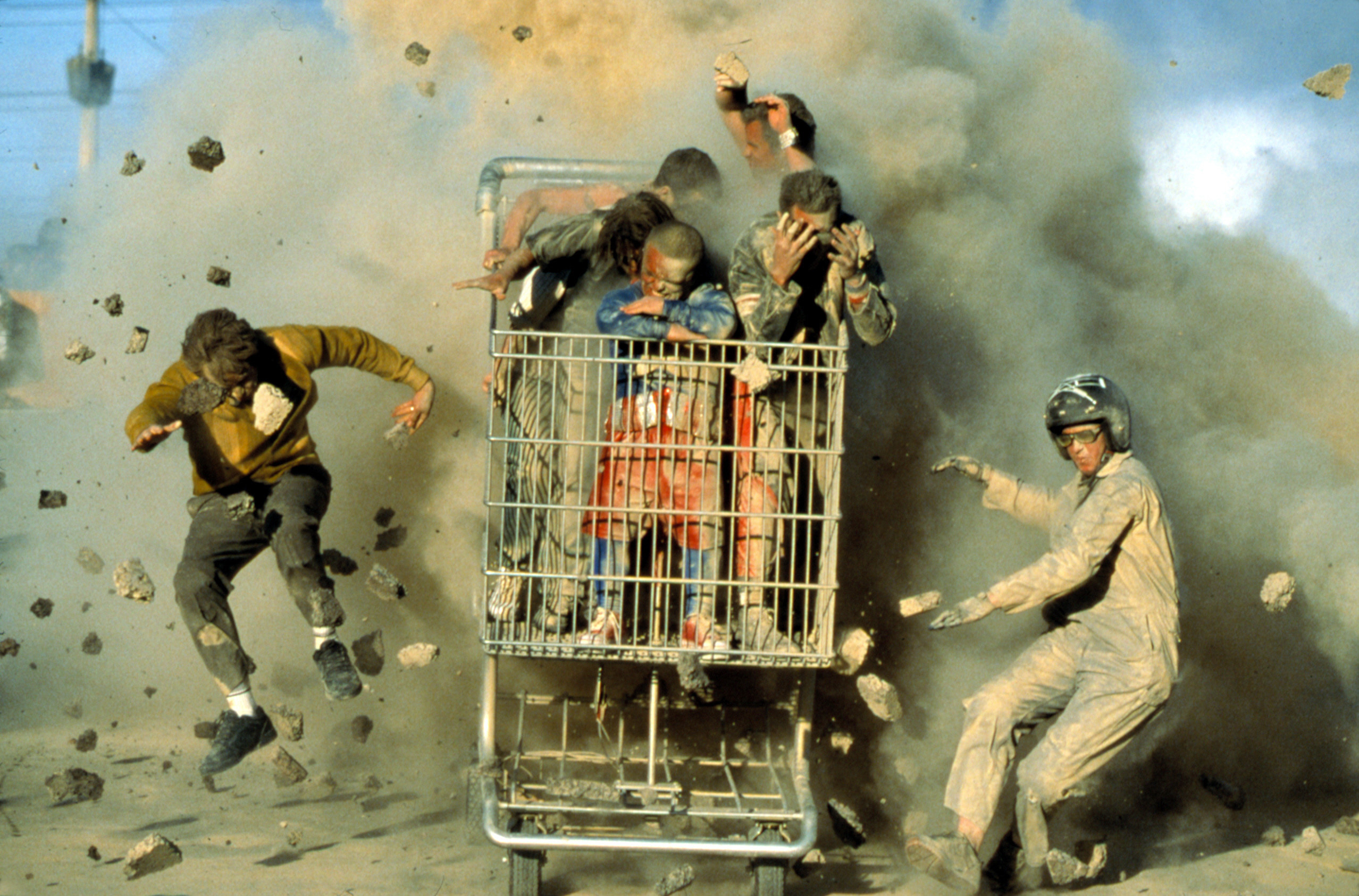 Cast of Jackass in a giant shopping cart in an explosion