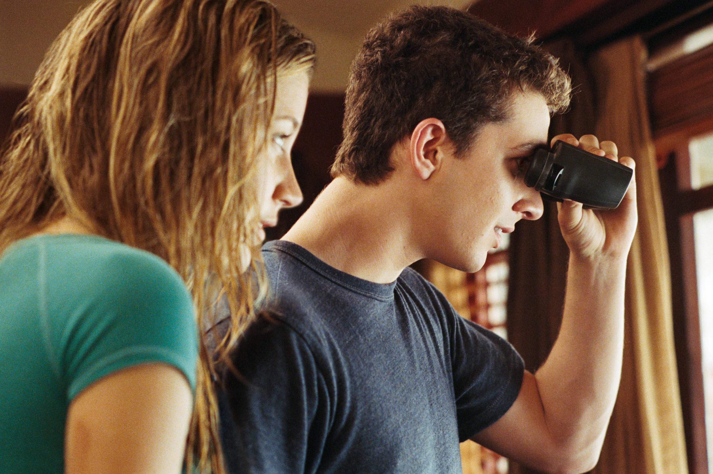 ShiaLaBeouf looking out of binoculars