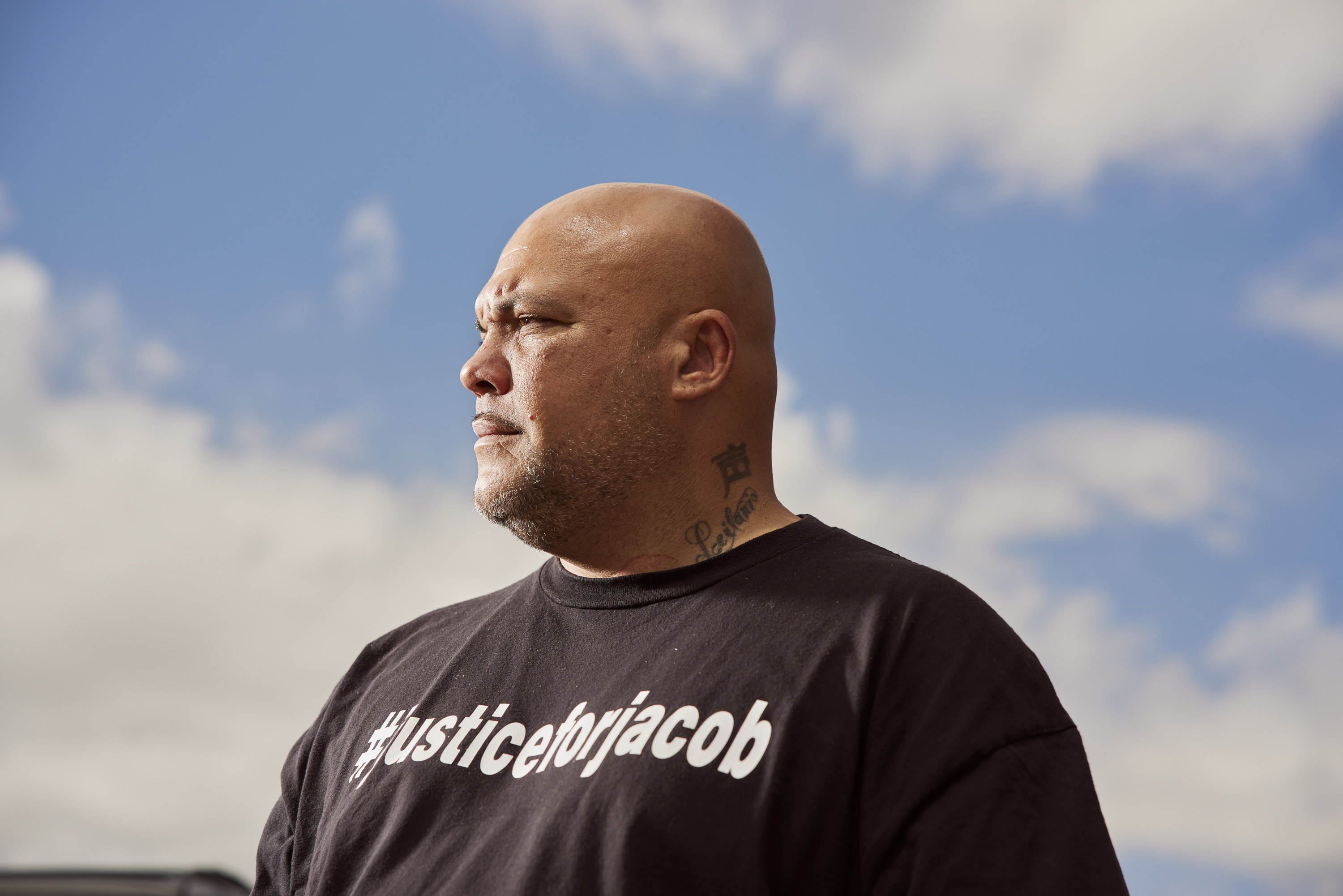 Roland Harris, photographed among the clouds, with a T-shirt that reads #justiceforjacob