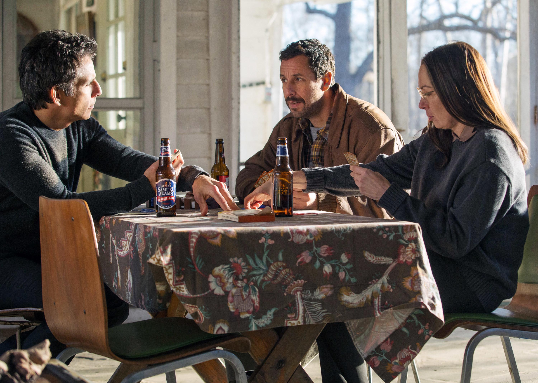 Ben Stiller, Adam Sandler, and Elizabeth Marvel playing cards and drinking beers.