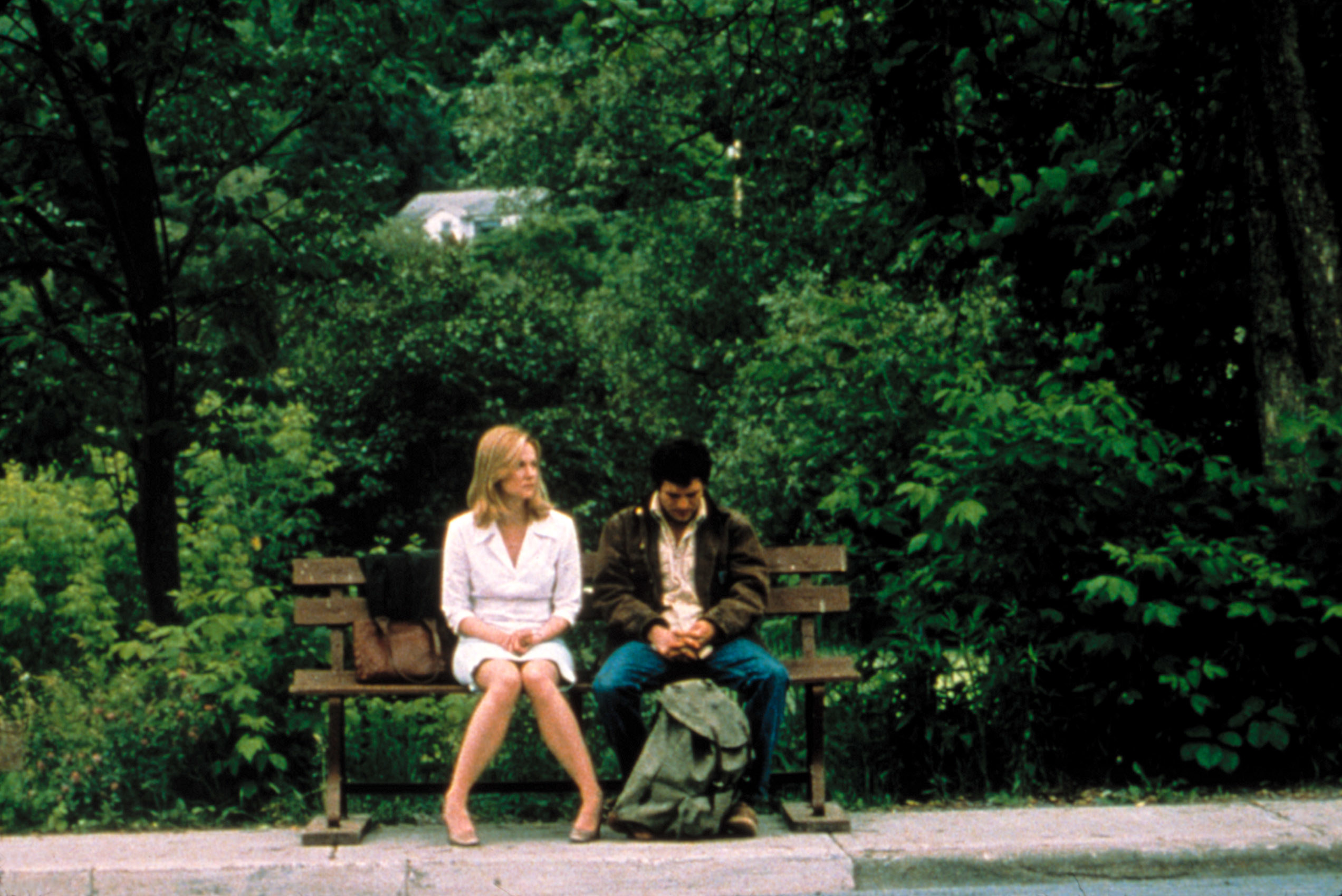 Laura Linney and Mark Ruffalo sitting on a bench.