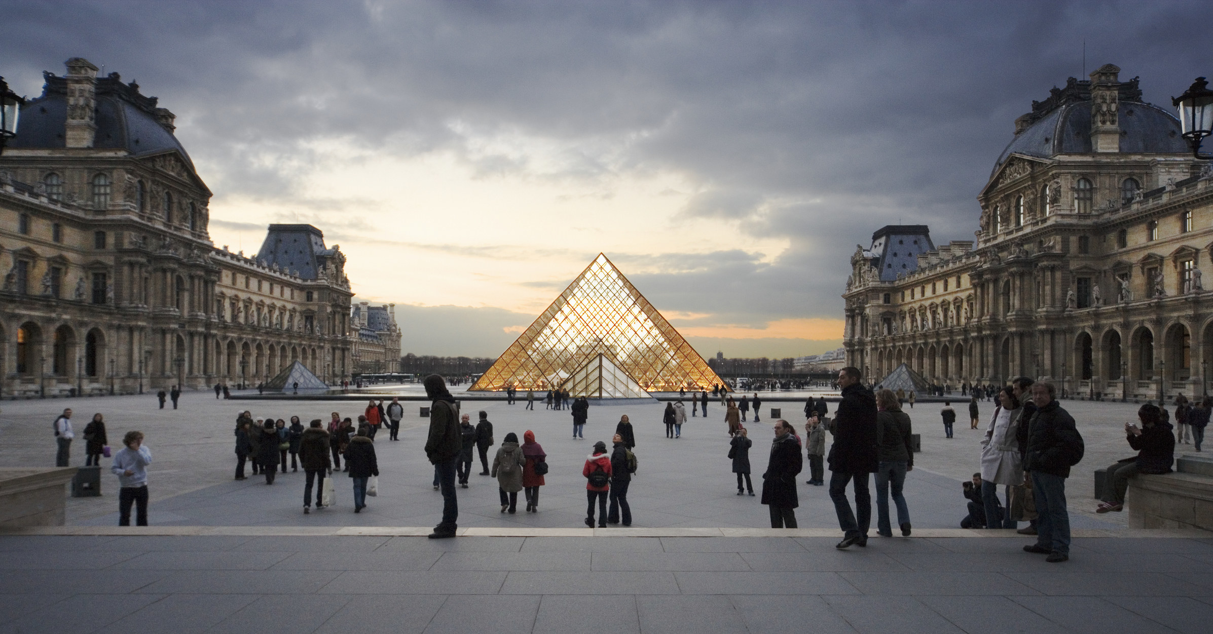 People outside of the Louvre in Paris.