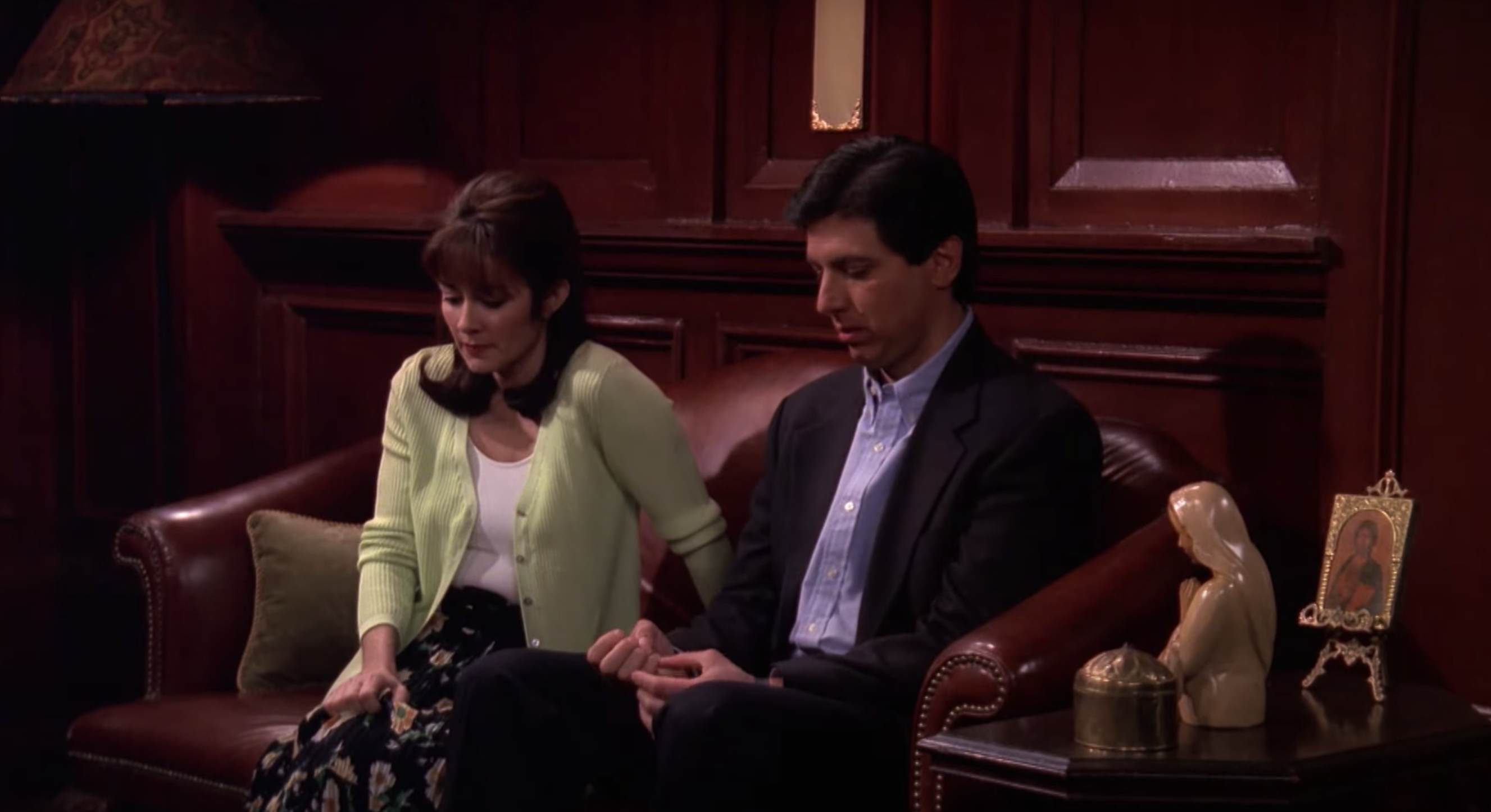 Ray and Debra sitting in an office in a church