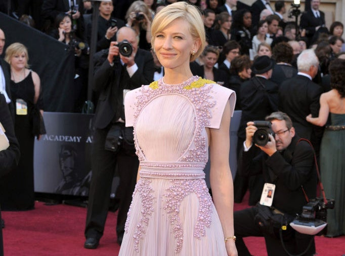Cate Blanchett posing on the red carpet at the 2011 Academy Awards