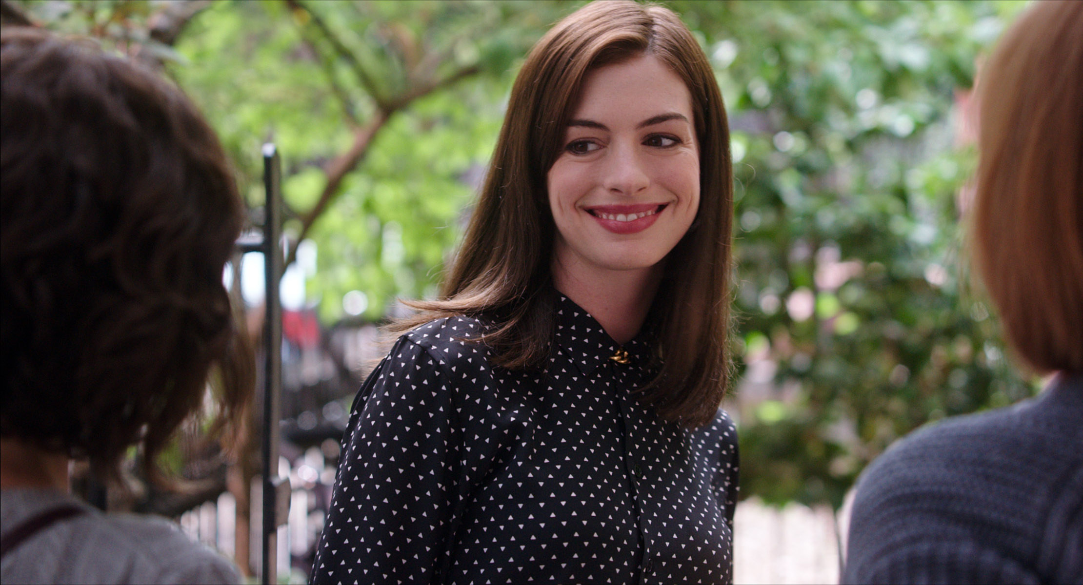 Anne Hathaway as Jules, smiling