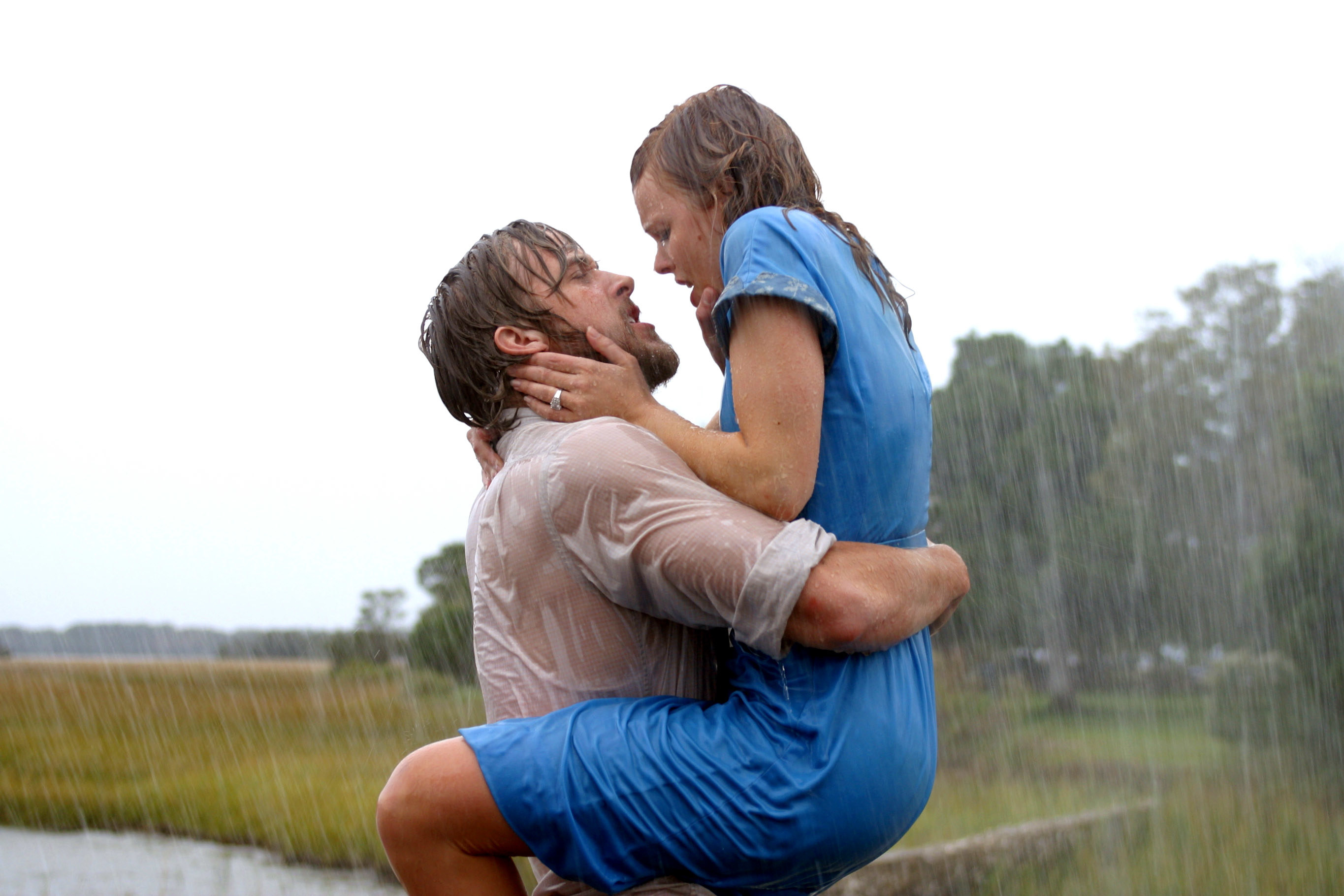 Noah and Allie hugging and about to kiss in the rain
