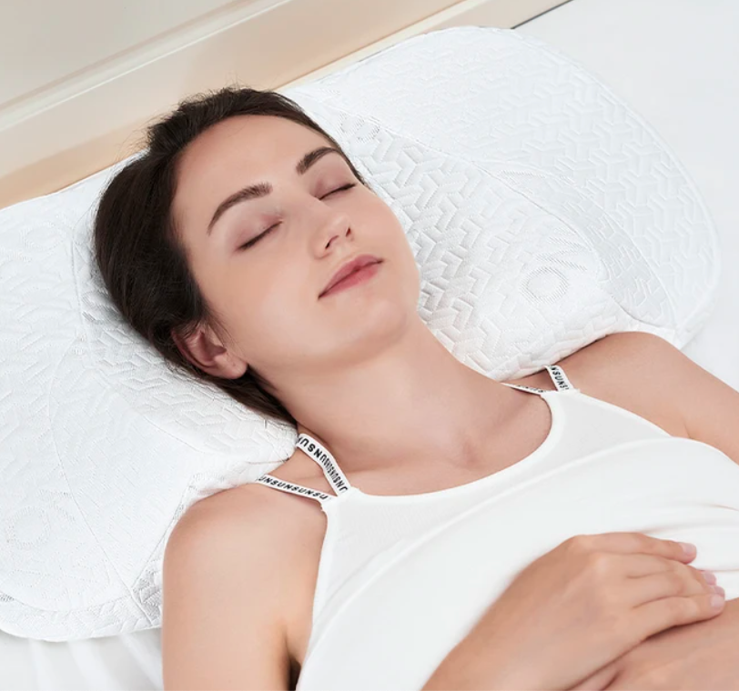 A person sleeping with their head on the pillow