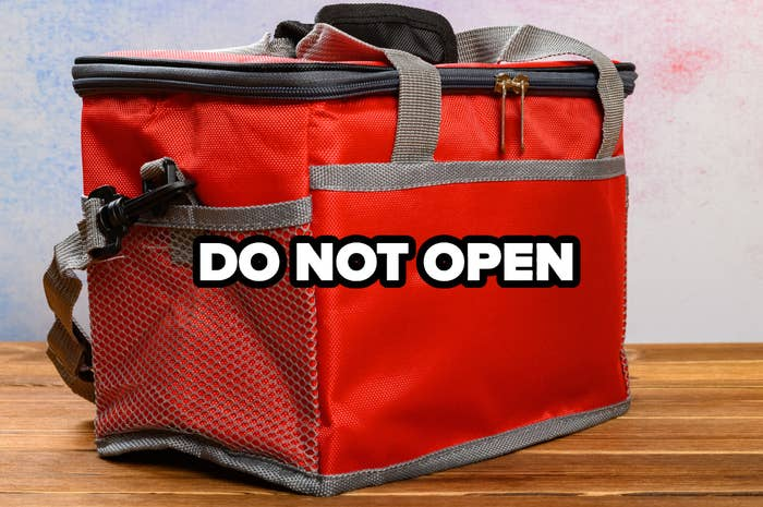 """a cooler with the words """"do not open"""" over the front"""