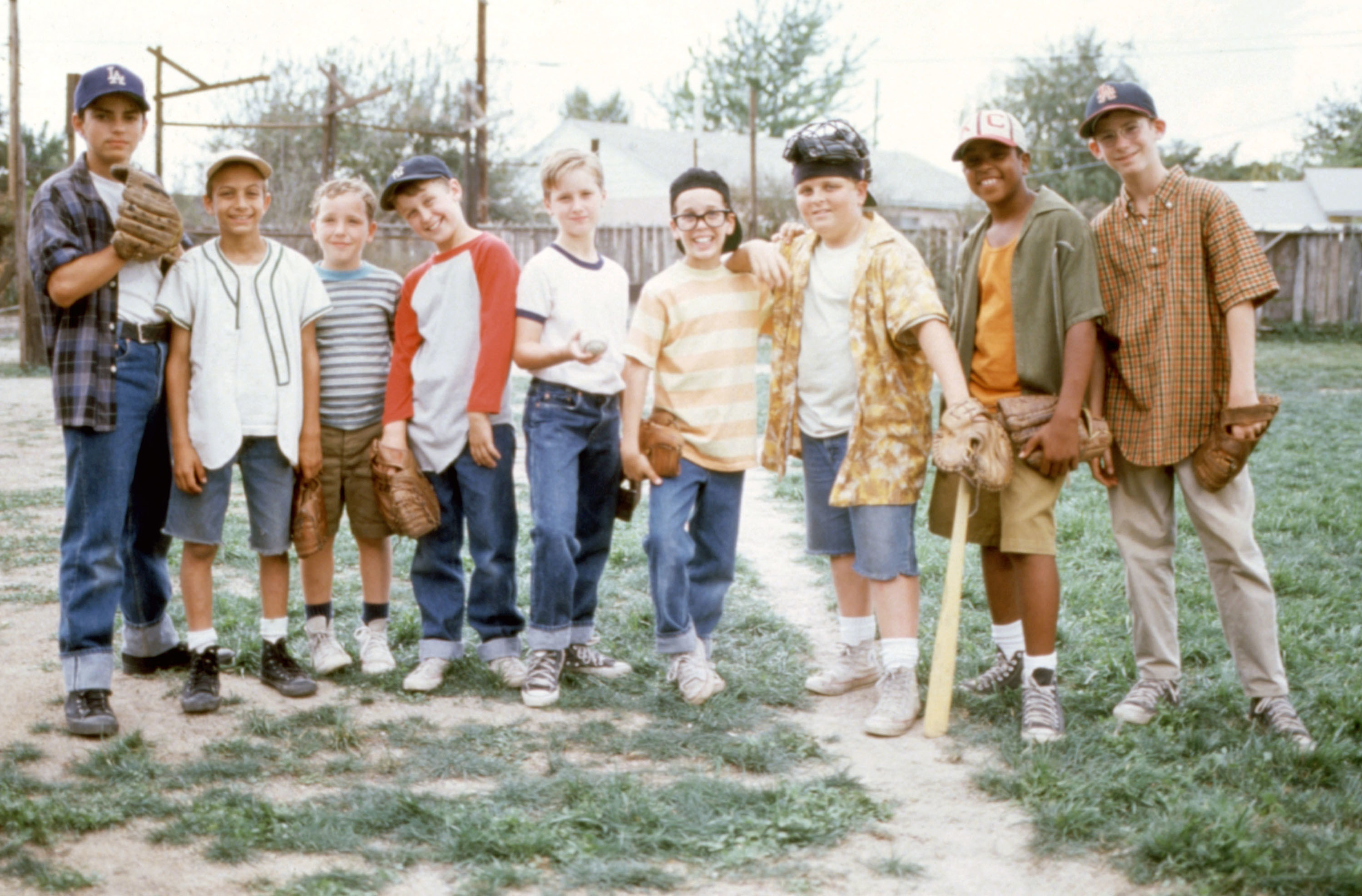 Mike Vitar, Marty York, Shane Obedzinski, Victor DiMattia, Tom Guiry, Chauncey Leopardi, Patrick Renna, Brandon Adams, and Grant Gelt stand on a baseball field