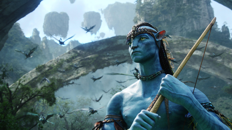 Sam Worthington as a Na'vi holds a bow