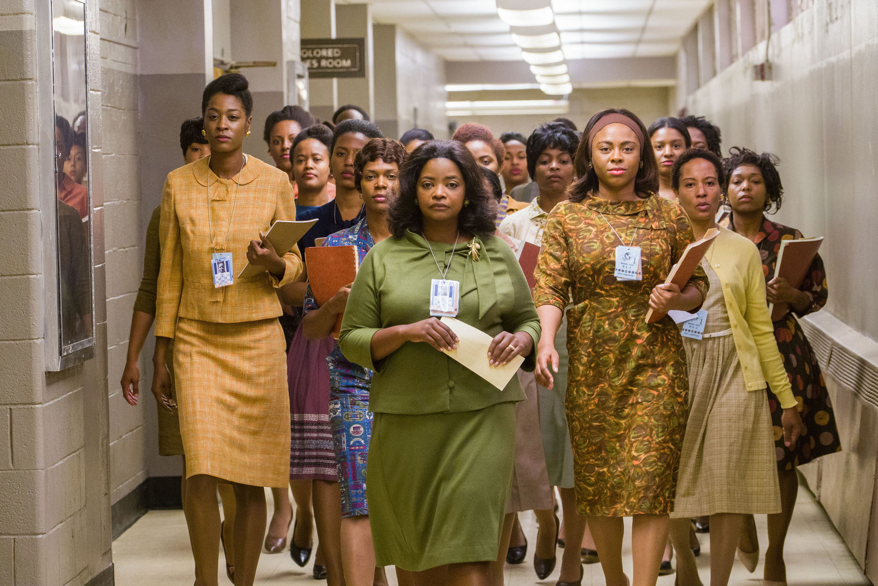 Octavia Spencer leads a group of Black women down a hallway